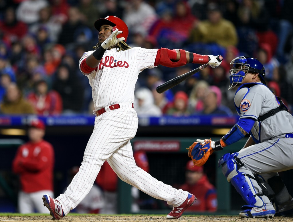 Philadelphia Phillies' Maikel Franco, left, watches the ball in front of New York Mets' Wilson Ramos after hitting a two-run home run off Noah Synderg