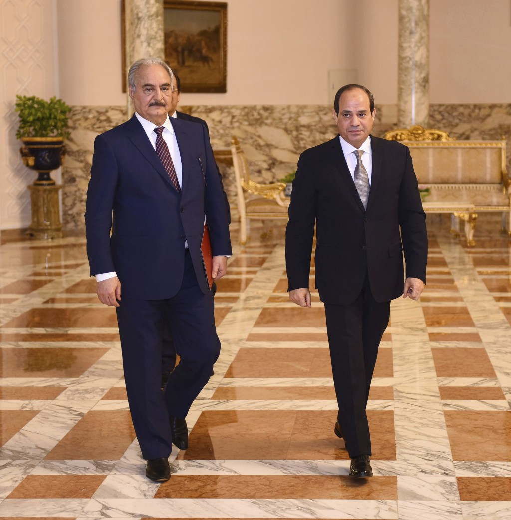 FILE - In this Sunday, April 14, 2019 file photo provided by Egypt's presidency media office, Egyptian President Abdel-Fattah el-Sissi, right, meets w