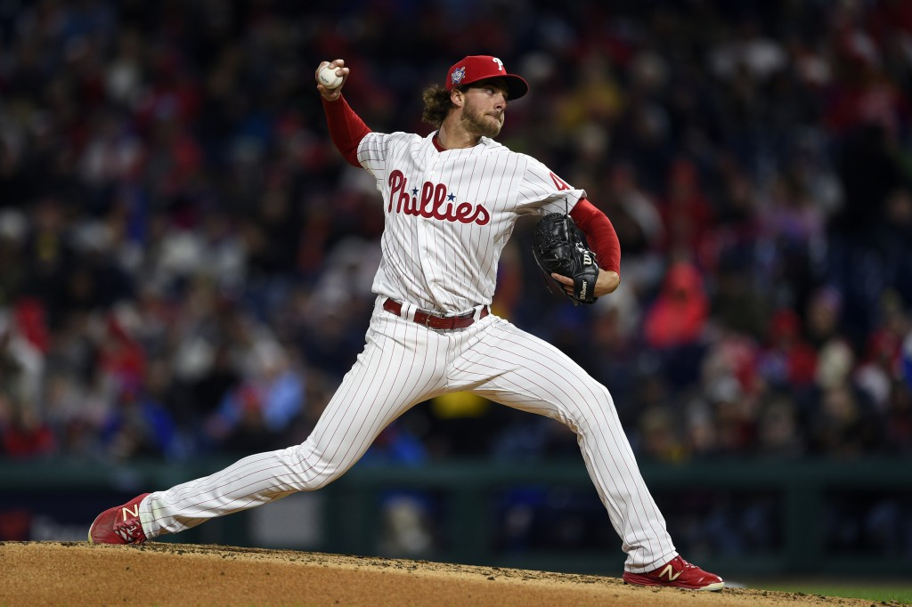 Philadelphia Phillies starting pitcher Aaron Nola throws the ball during the third inning of a baseball game against the New York Mets, Monday, April
