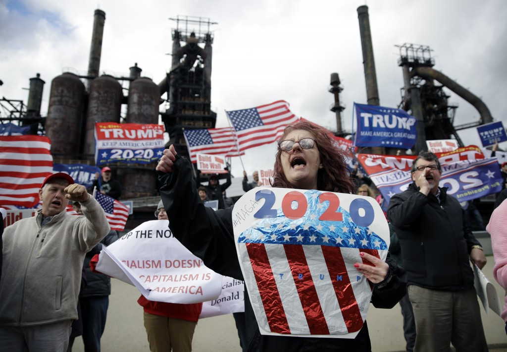 Protesters demonstrate in support of President Donald Trump near a Fox News town-hall style event with U.S. Sen. Bernie Sanders, Monday, April 15, 201