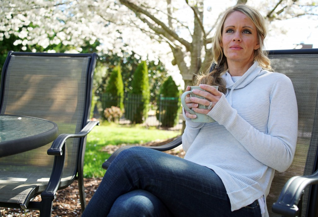 In this Wednesday, March 27, 2019, photo, Kacey Ruegsegger Johnson enjoys a coffee in a light spring breeze in the back yard of her home in Cary, N.C....