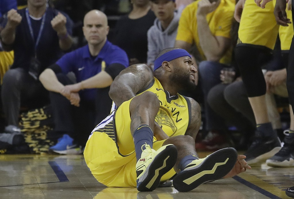 Golden State Warriors center DeMarcus Cousins reacts after falling to the floor during the first half of Game 2 of a first-round NBA basketball playof