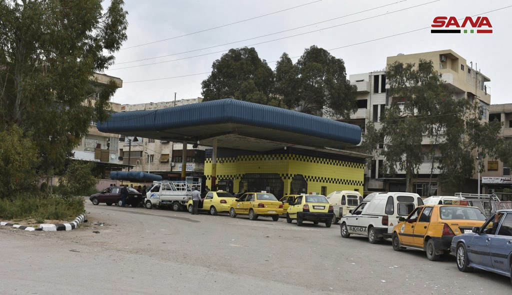 In this photo released on April 7, 2019, by the Syrian official news agency SANA, Shows cars queuing to fill their tanks with fuel, at a gas station i