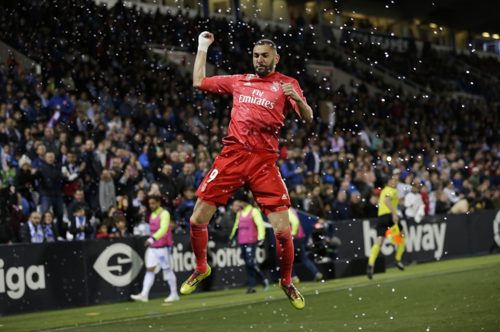Real Madrid's Karim Benzema celebrates after scoring against Leganes during a Spanish La Liga soccer match in Leganes, outskirts Madrid, Spain, Monday
