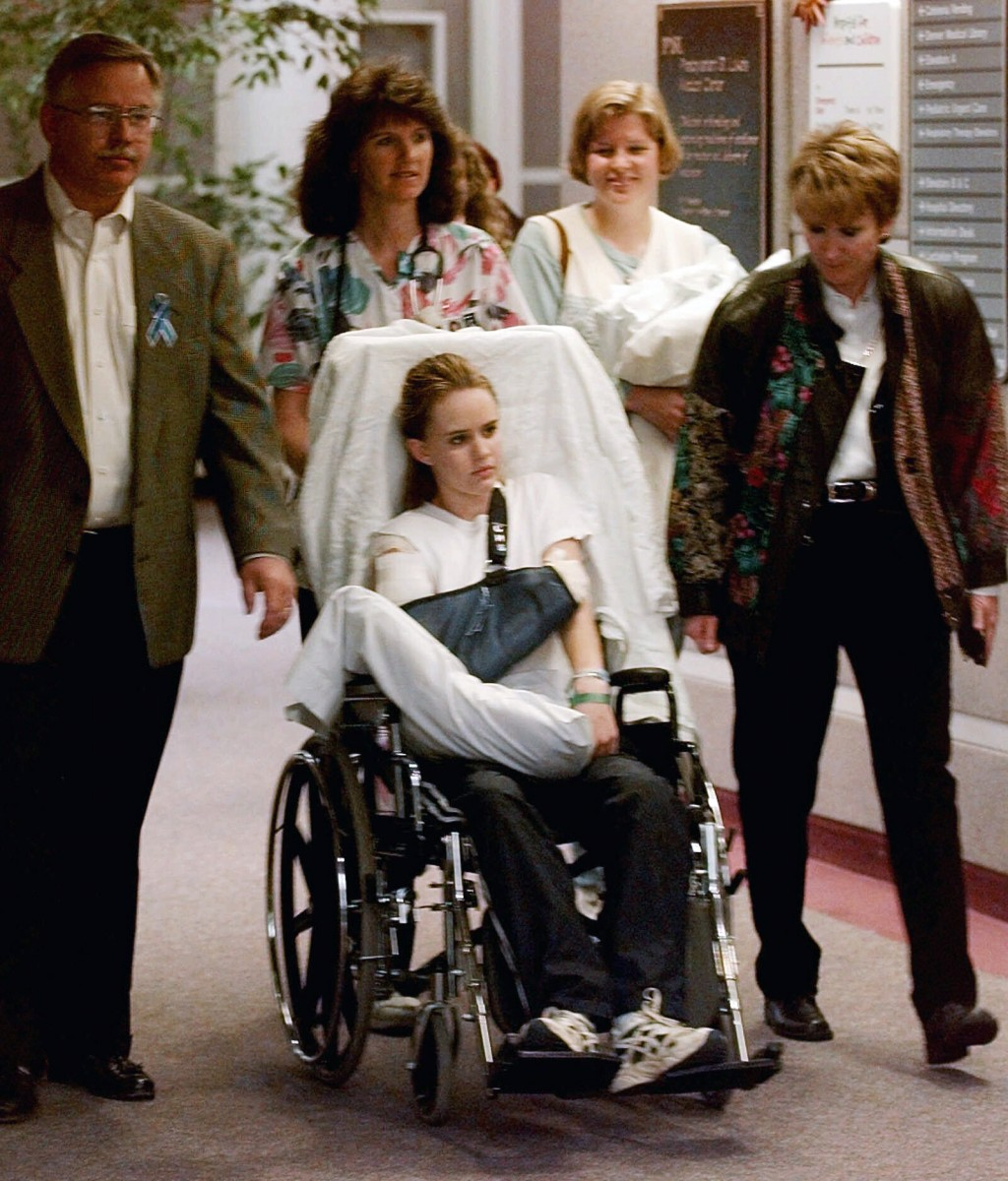 FILE - In this May 1, 1999, file photo, Kacey Ruegsegger, 17, is wheeled from a Denver hospital by Patty Anderson, center, after being released. Walki...