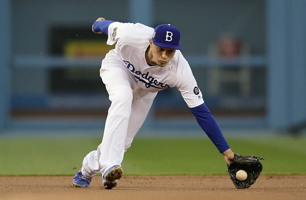 Los Angeles Dodgers shortstop Corey Seager fields a ball hit by Cincinnati Reds' Curt Casali during the first inning of a baseball game, Monday, April