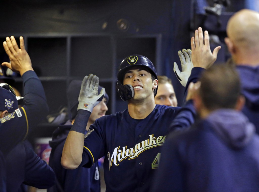 Milwaukee Brewers' Christian Yelich reacts after his home run against the St. Louis Cardinals during the eighth inning of a baseball game Monday, Apri...
