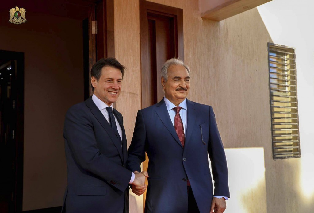 FILE - In this Dec. 23 2018 file photo, Italian premier Giuseppe Conte, left, poses with the head of the self-styled Libyan National Army Khalifa Hift