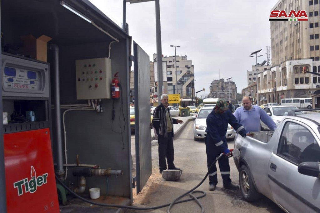In this photo released on April 7, 2019, by the Syrian official news agency SANA, Shows a worker fills a pickup at a gas station, in Homs, Syria. Syri