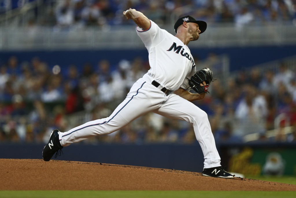 Miami Marlins starting pitcher Trevor Richards delivers during the first inning of a baseball game against the Chicago Cubs, Monday, April 15, 2019, i