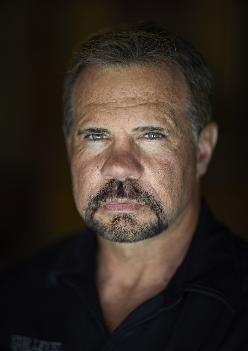 In this April 9, 2019, photo, Grant Whitus poses for a portrait at his home in Lake Havasu City, Ariz. Whitus' marriage fell apart a year after he led