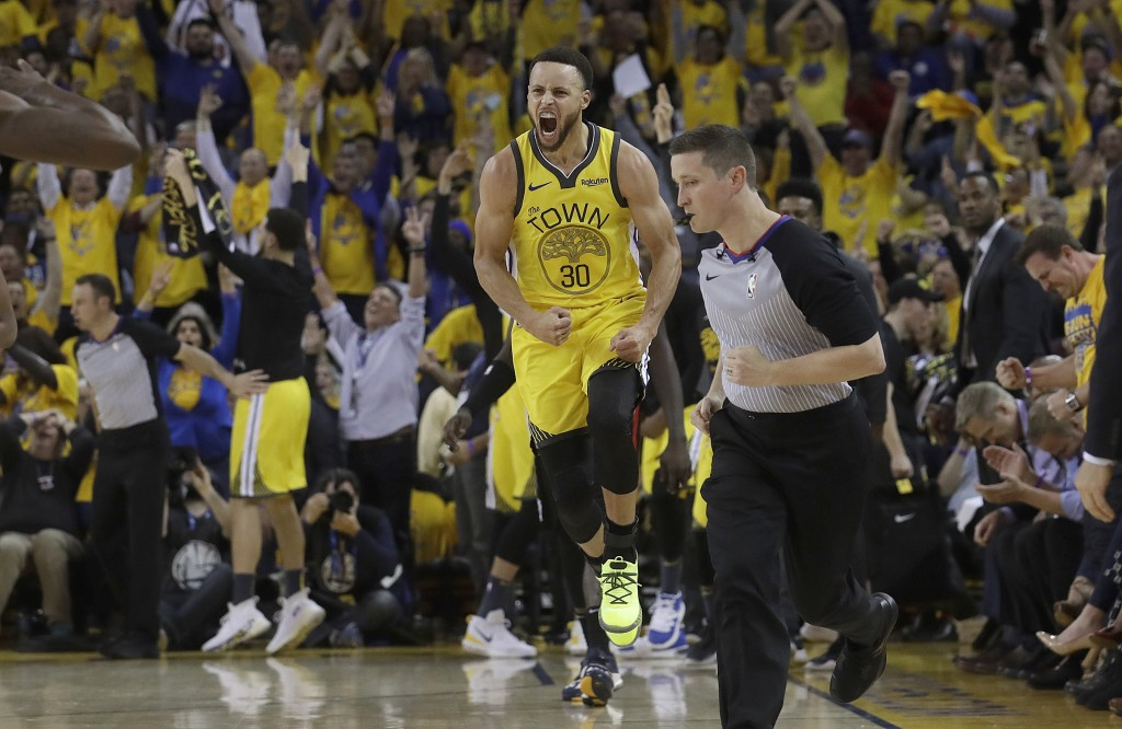 Golden State Warriors guard Stephen Curry (30) celebrates after scoring against the Los Angeles Clippers during the first half of Game 2 of a first-ro