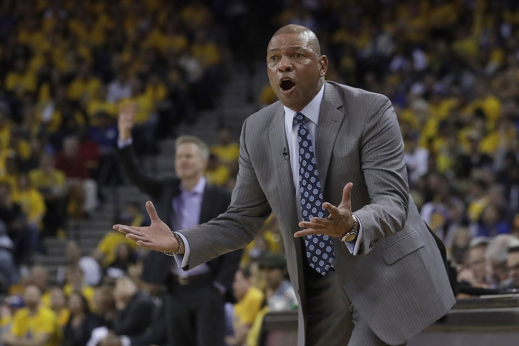 Los Angeles Clippers head coach Doc Rivers gestures toward an official during the first half of Game 2 of a first-round NBA basketball playoff series