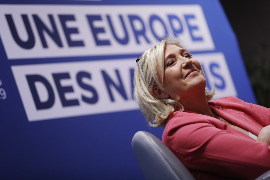 Far-right leader of the National Rally party Marine Le Pen, smiles as she attends a media conference for the upcoming European elections next month in