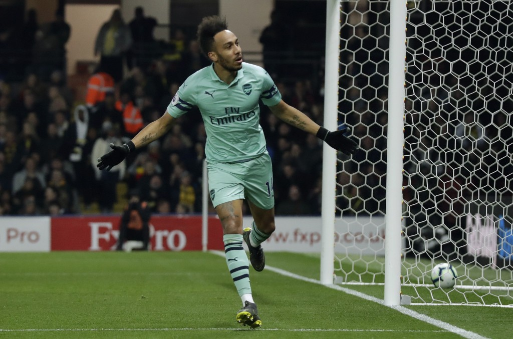 Arsenal's Pierre-Emerick Aubameyang celebrates after scoring the opening goal during the English Premier League soccer match between Watford and Arsen
