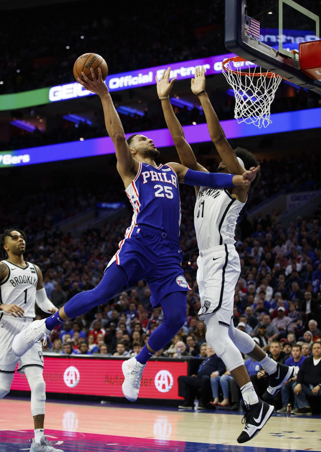Philadelphia 76ers' Ben Simmons, left, of Australia, goes up for the shot against Brooklyn Nets' Jarrett Allen, right, during the first half in Game 2