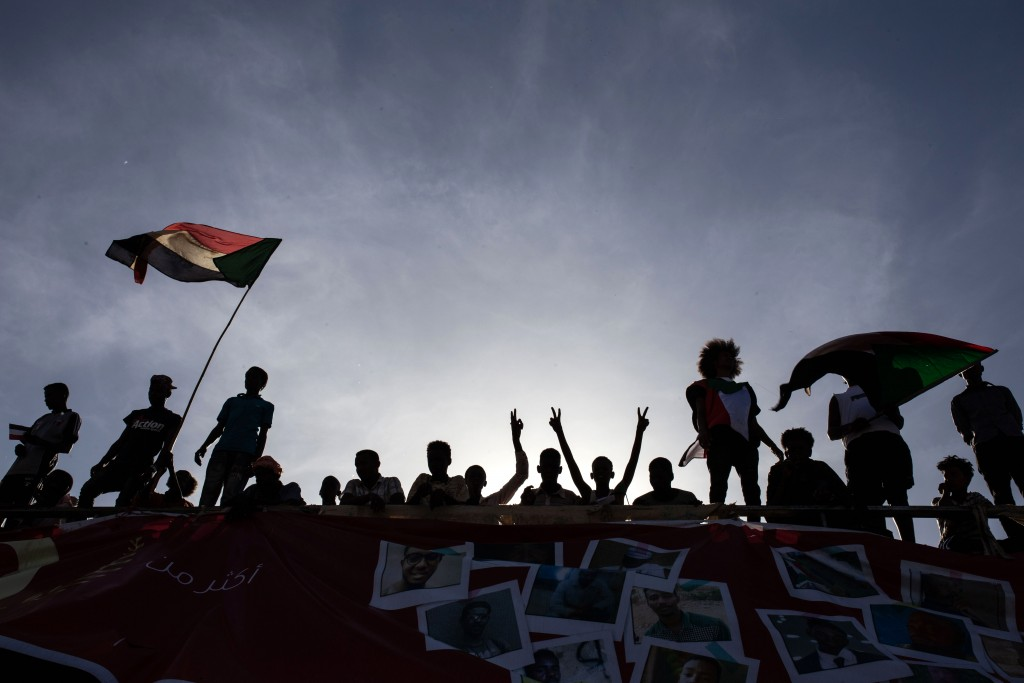 """Demonstrators rally near the military headquarters in Khartoum, Sudan, Monday, April 15, 2019. The Sudanese protest movement on Monday welcomed the """"p"""