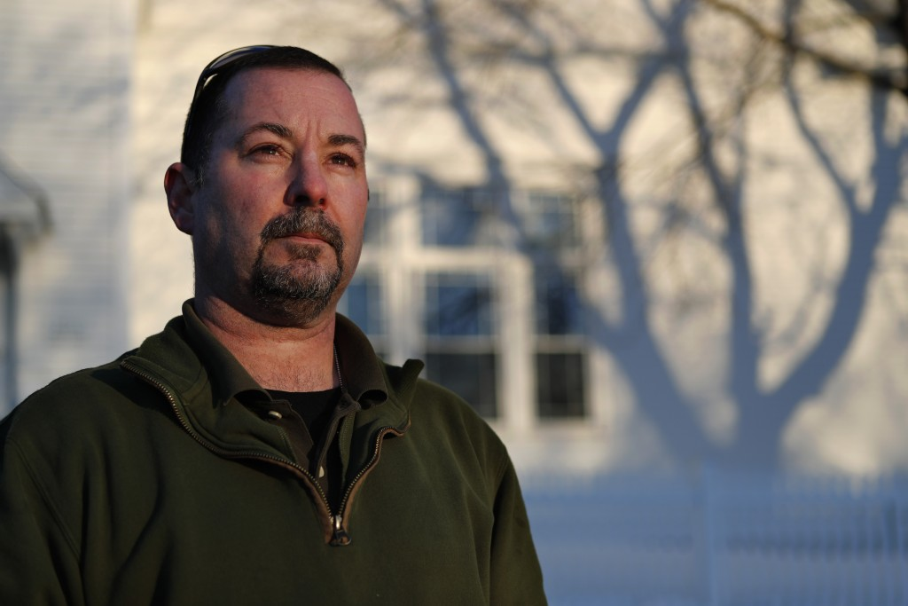 In this Tuesday, March 12, 2019 photo, former SWAT officer Al Joyce poses in Norway, Maine. Joyce left his job in law enforcement in Jefferson County,