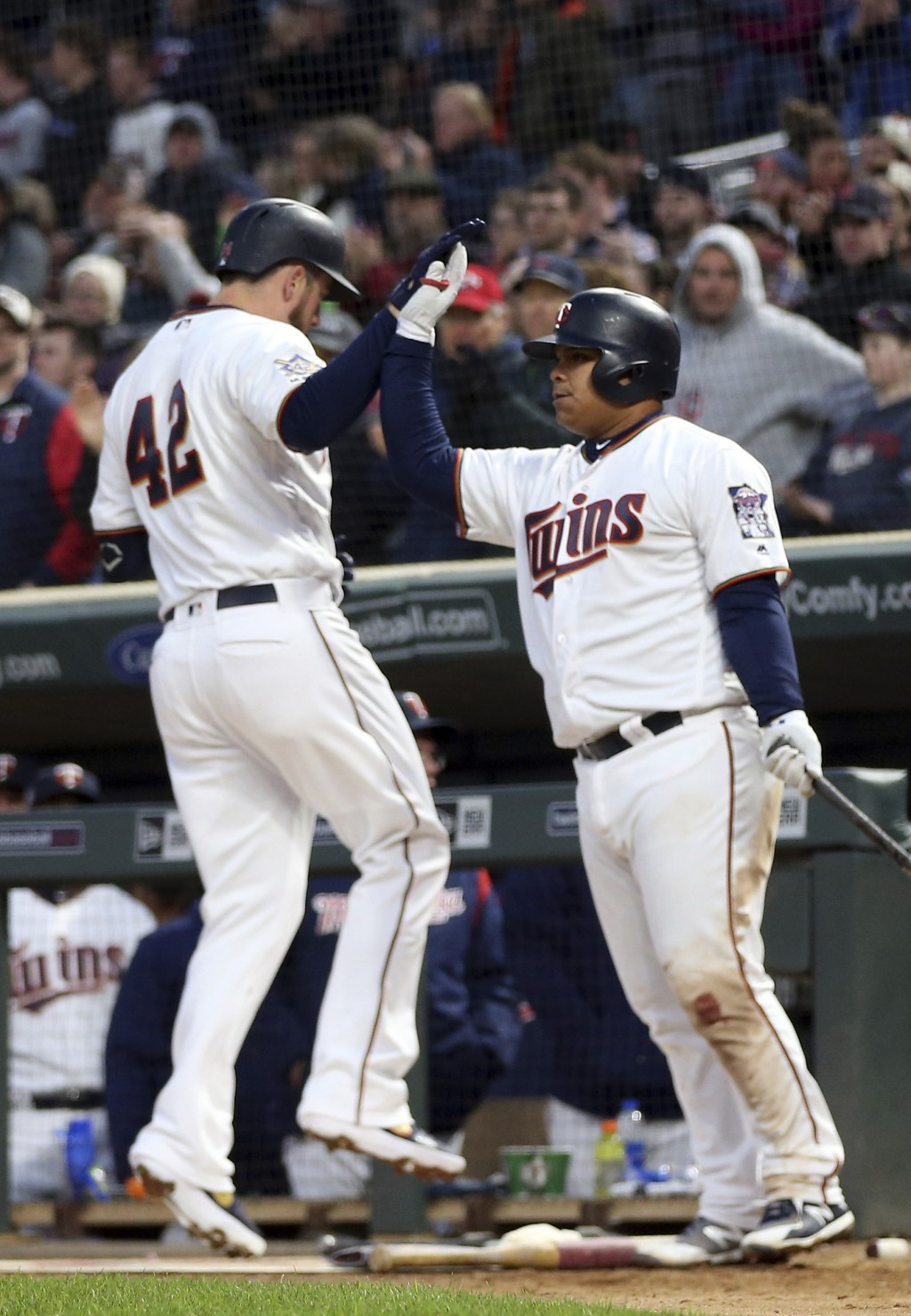 Minnesota Twins' C.J. Cron, left, celebrates his three-run home run off Toronto Blue Jays pitcher Matt Shoemaker with Willians Astudillo in the fourth