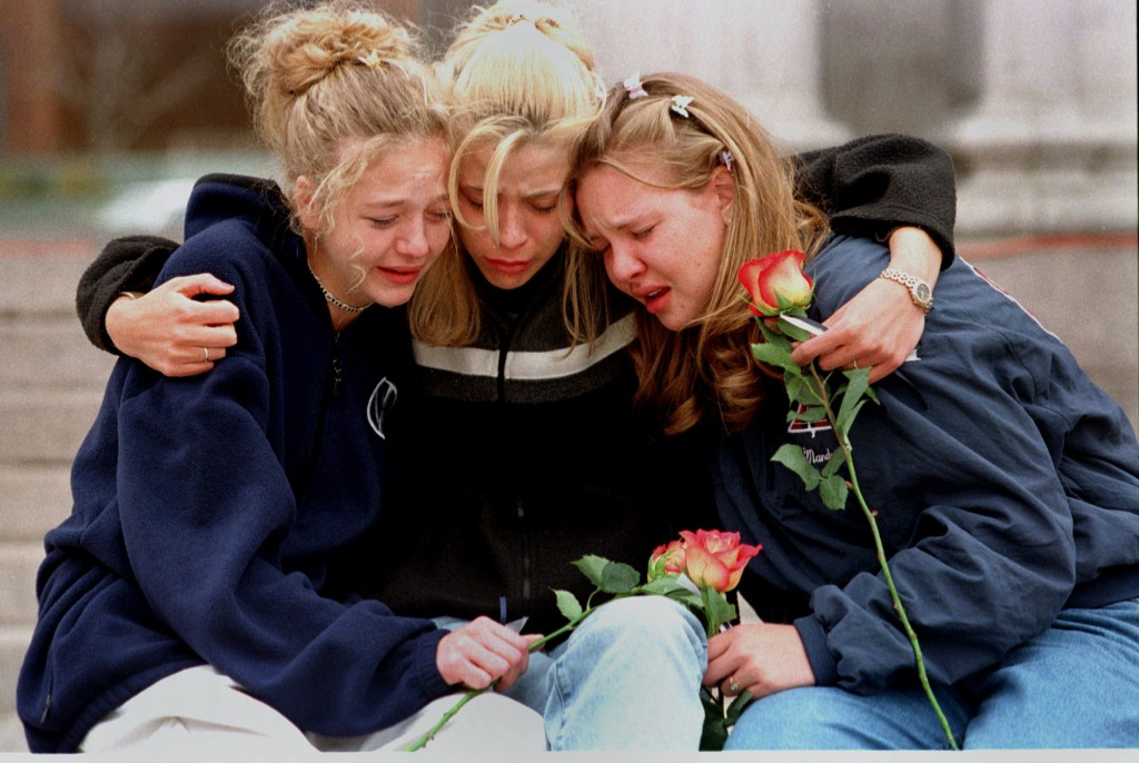 FILE - In this April 21, 1999, file photo, from left, Rachel Ruth, Rhianna Cheek and Mandi Annibel, all 16-year-old sophomores at Heritage High School