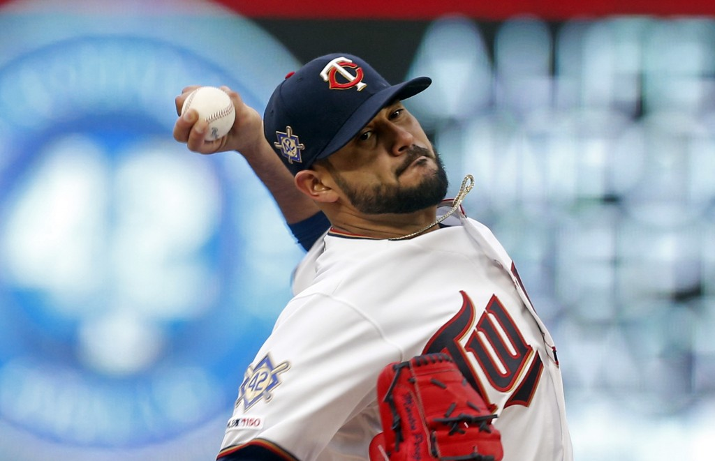 Minnesota Twins' pitcher Martin Perez throws against the Toronto Blue Jays in the first inning of a baseball game Monday, April 15, 2019, in Minneapol