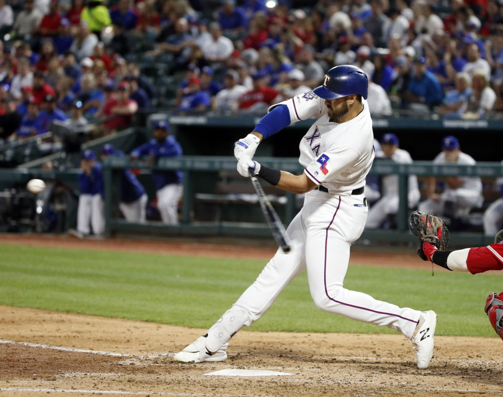 Texas Rangers' Joey Gallo hits a solo home run against the Los Angeles Angels during the third inning of a baseball game Monday, April 15, 2019, in Ar...