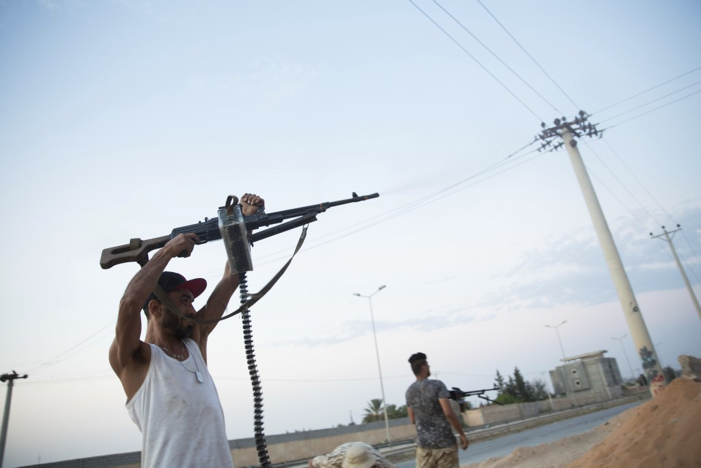 FILE - This Sept. 21, 2018 file photo, shows fighters under the UN-backed government on the front lines during clashes in southern Tripoli. Libya is o