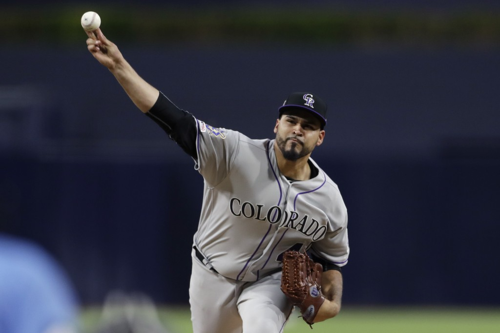 Colorado Rockies starting pitcher Antonio Senzatela works against a San Diego Padres batter during the first inning of a baseball game Monday, April 1