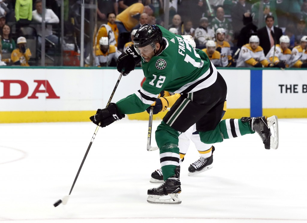 Dallas Stars center Radek Faksa (12) shoots against the Nashville Predators in the first period of Game 3 in an NHL hockey first-round playoff series