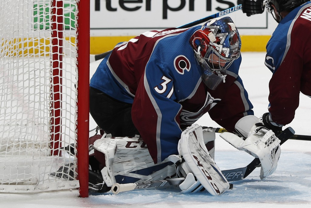 Colorado Avalanche goaltender Philipp Grubauer stops a shot against the Calgary Flames in the second period of Game 3 of a first-round NHL hockey play