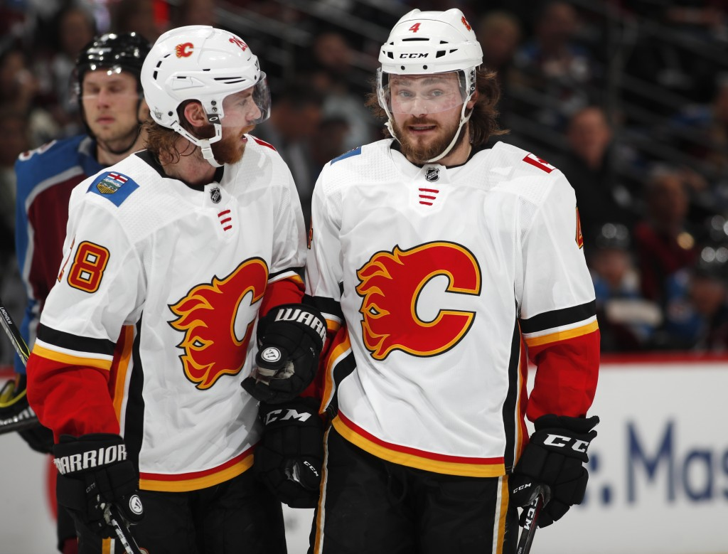 Calgary Flames center Elias Lindholm, left, confers with defenseman Rasmus Andersson in the second period of Game 3 of a first-round NHL hockey playof