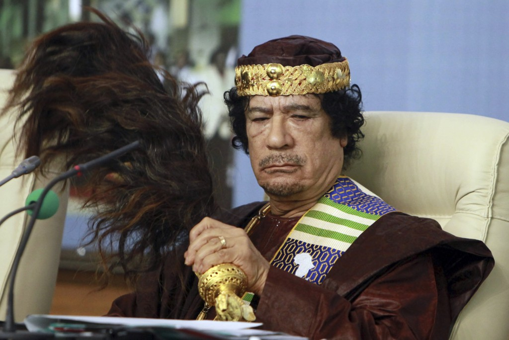 FILE - In this Sept. 8 2010 file photo, then Libyan leader Moammar Gadhafi attends a ceremony in Tripoli. The country slid into chaos after the 2011 u
