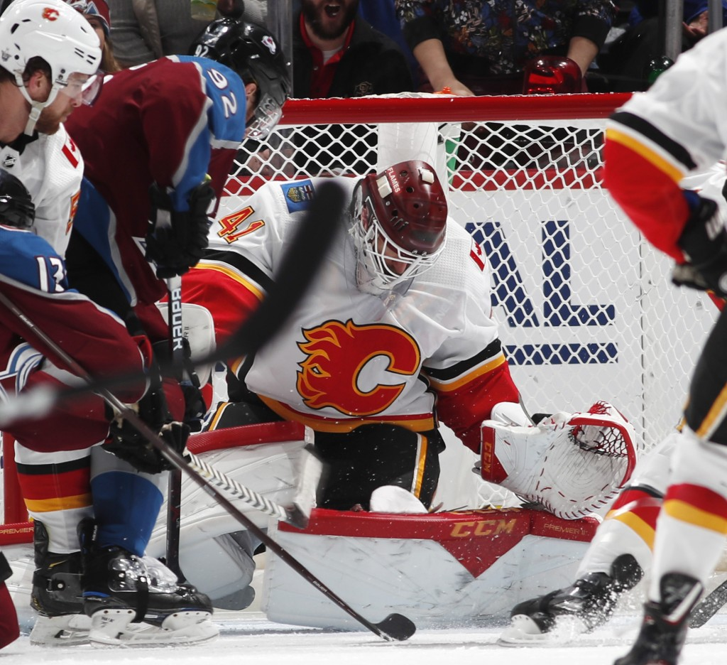 Calgary Flames goaltender Mike Smith, right, makes a stop of a shot by Colorado Avalanche left wing Gabriel Landeskog in the second period of Game 3 o