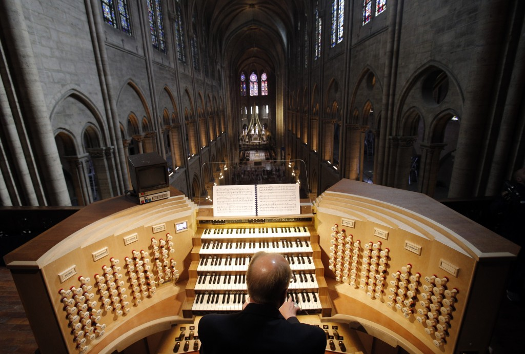 FILE - In this Thursday, May 2, 2013 file photo, Philippe Lefebvre, 64, plays the organ at Notre Dame cathedral in Paris.  (AP Photo/Christophe Ena, f