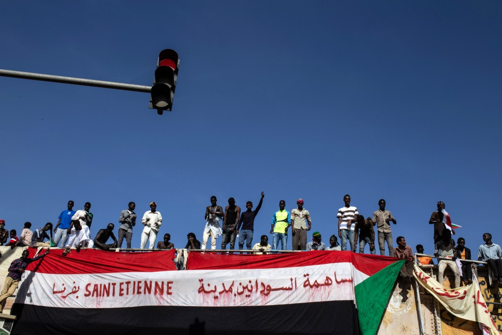"Demonstrators rally near the military headquarters in Khartoum, Sudan, Monday, April 15, 2019. The Sudanese protest movement on Monday welcomed the ""p"