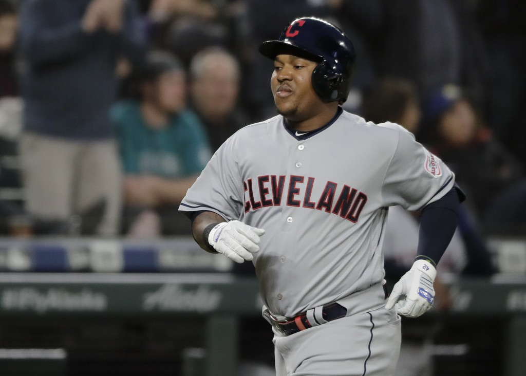 Cleveland Indians Jose Ramirez rounds the bases after hitting a solo home run during the third inning of a baseball game against the Seattle Mariners,