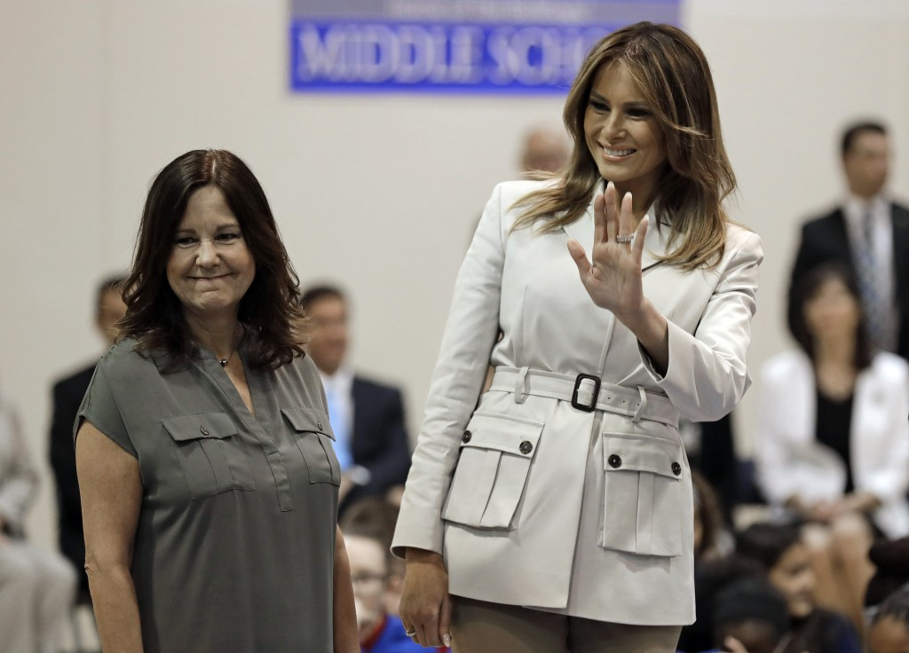 First lady Melania Trump, right, and second lady Karen Pence, left, greet students at Albritton Middle School in Fort Bragg, N.C., Monday, April 15, 2