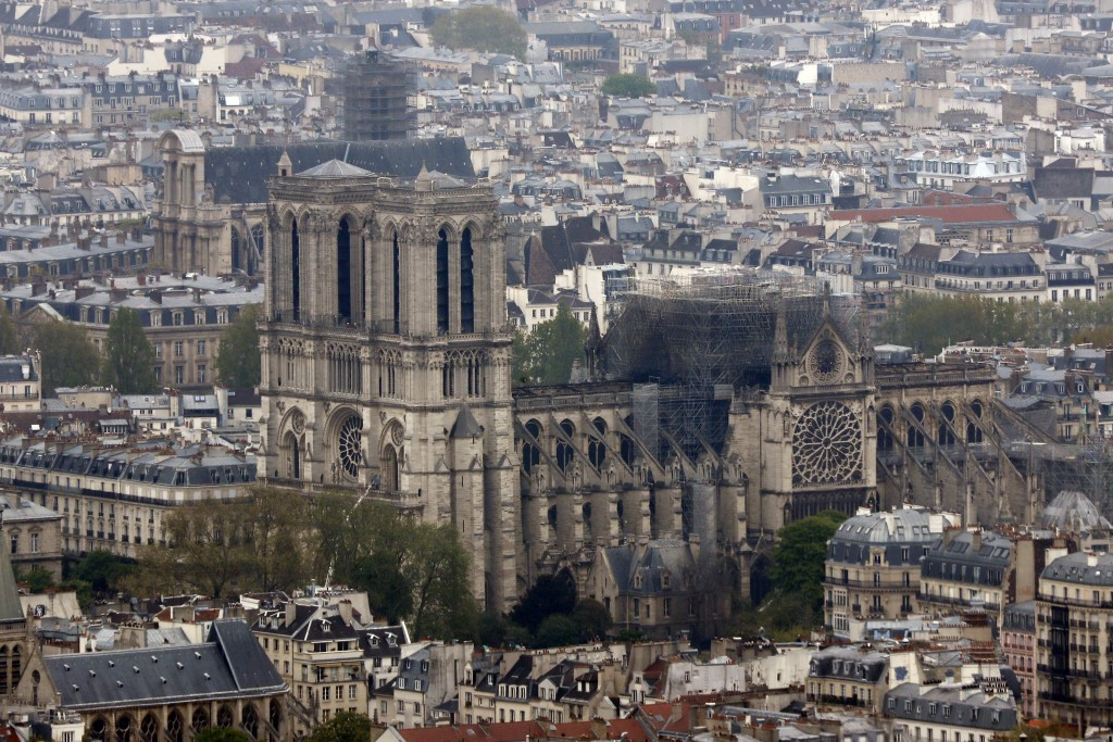 Notre Dame cathedral is pictured from the top of the Montparnasse tower, Tuesday April 16, 2019 in Paris. Firefighters declared success Tuesday mornin...
