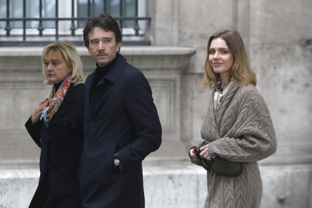 Antoine Arnault, son of LVMH president Bernard Arnault, and his wife Natalia Vodianova, right, arrive at the damaged Notre Dame cathedral after the fi
