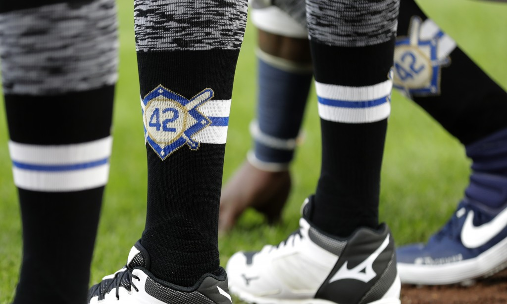 Seattle Mariners players wear No. 42 on their socks in honor of Jackie Robinson Day before a baseball game against the Cleveland Indians, Monday, Apri