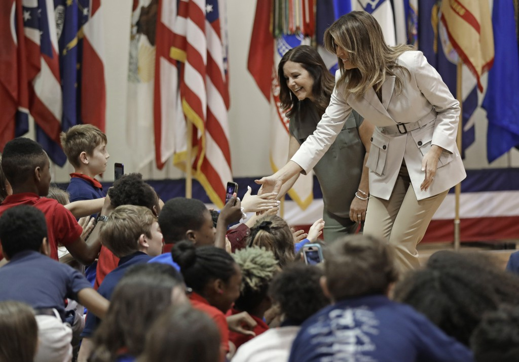 First lady Melania Trump, right, and second lady Karen Pence, left, greet student at Albritton Middle School in Fort Bragg, N.C., Monday, April 15, 20