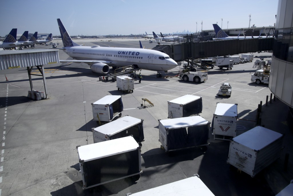 FILE - In this July 18, 2018, file photo a United Airlines commercial jet sits at a gate at Terminal C of Newark Liberty International Airport in Newa