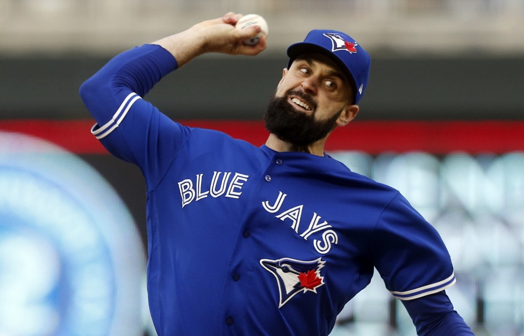 Toronto Blue Jays pitcher Matt Shoemaker throws against the Minnesota Twins in the first inning of a baseball game Monday, April 15, 2019, in Minneapo
