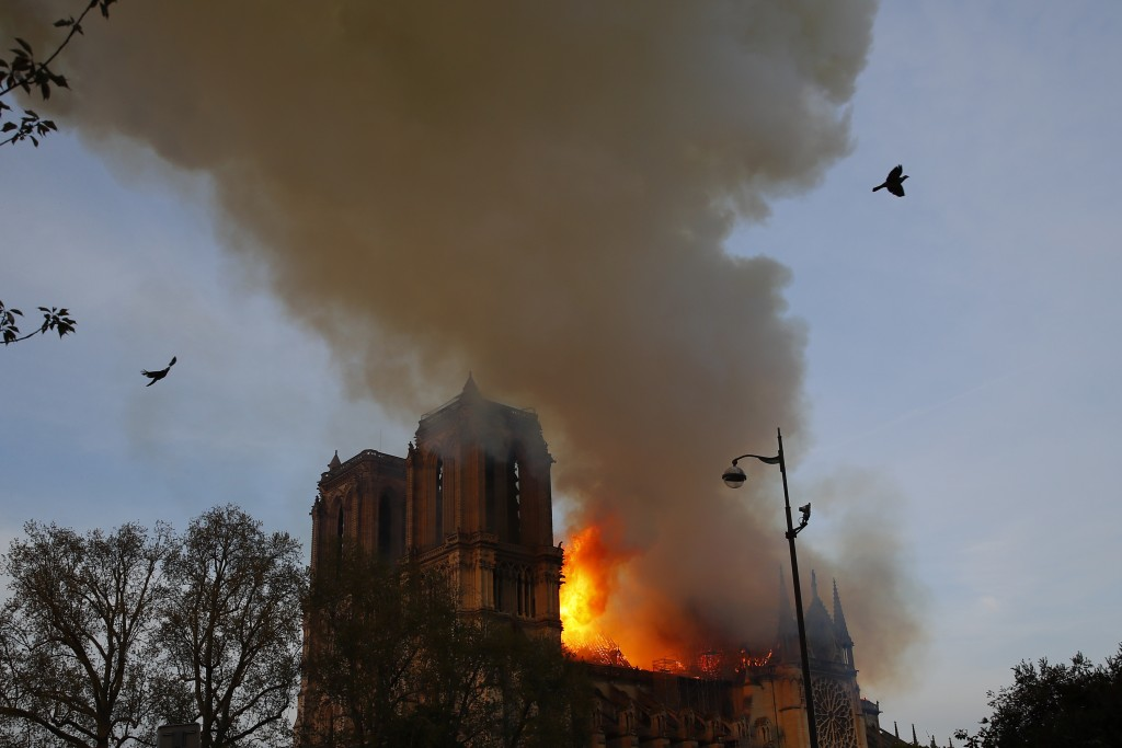 Notre Dame cathedral is burning in Paris, Monday, April 15, 2019. A catastrophic fire engulfed the upper reaches of Paris' soaring Notre Dame Cathedra