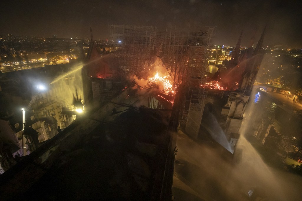 This aerial photo provided Tuesday April 16, 2019 by the Paris Fire Brigade shows Notre Dame cathedral burning, Monday April 15, 2019. Experts assesse...