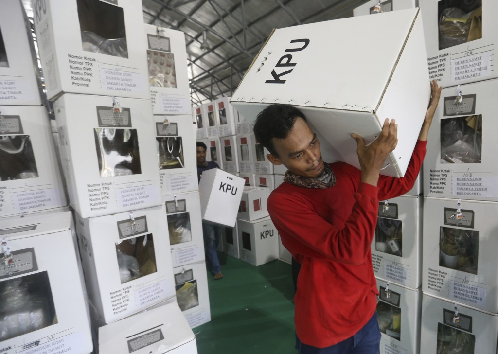 Workers carry ballot boxes to be distributed to polling stations in Jakarta, Indonesia, Tuesday, April 16, 2019. Nearly 193 million Indonesians are el