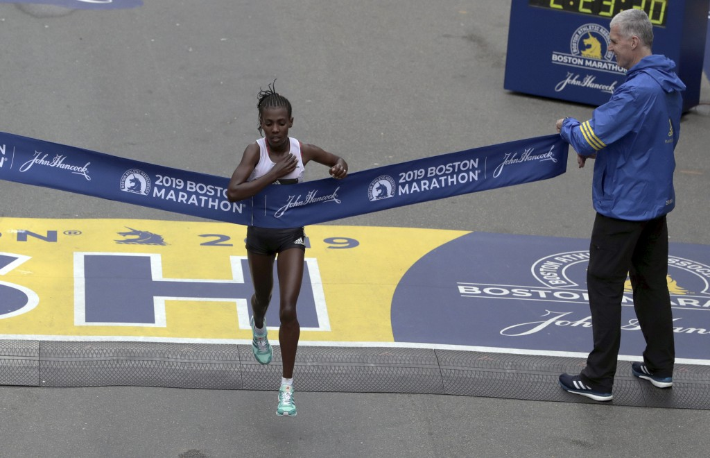 Worknesh Degefa, of Ethiopia, breaks the tape to win the women's division of the 123rd Boston Marathon on Monday, April 15, 2019, in Boston. (AP Photo