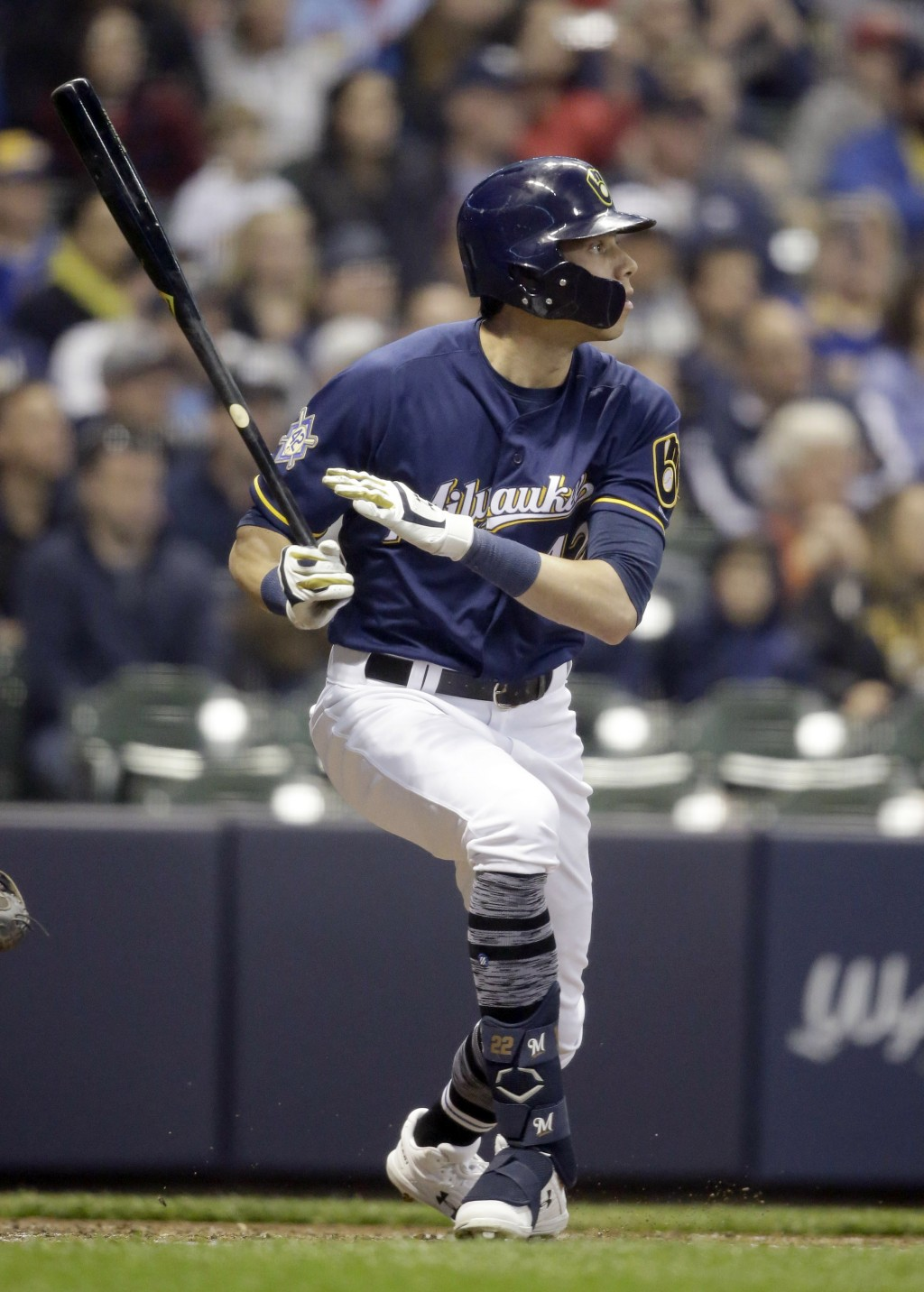 Milwaukee Brewers' Christian Yelich watches his three-run home run against the St. Louis Cardinals during the second inning of a baseball game Monday,