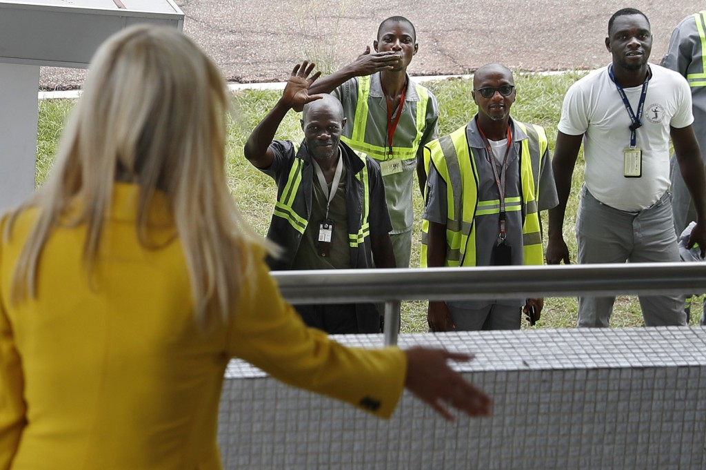 U.S. White House senior adviser Ivanka Trump, left, waves back at airport workers as one blows a kiss and others wave as she arrives at the airport in