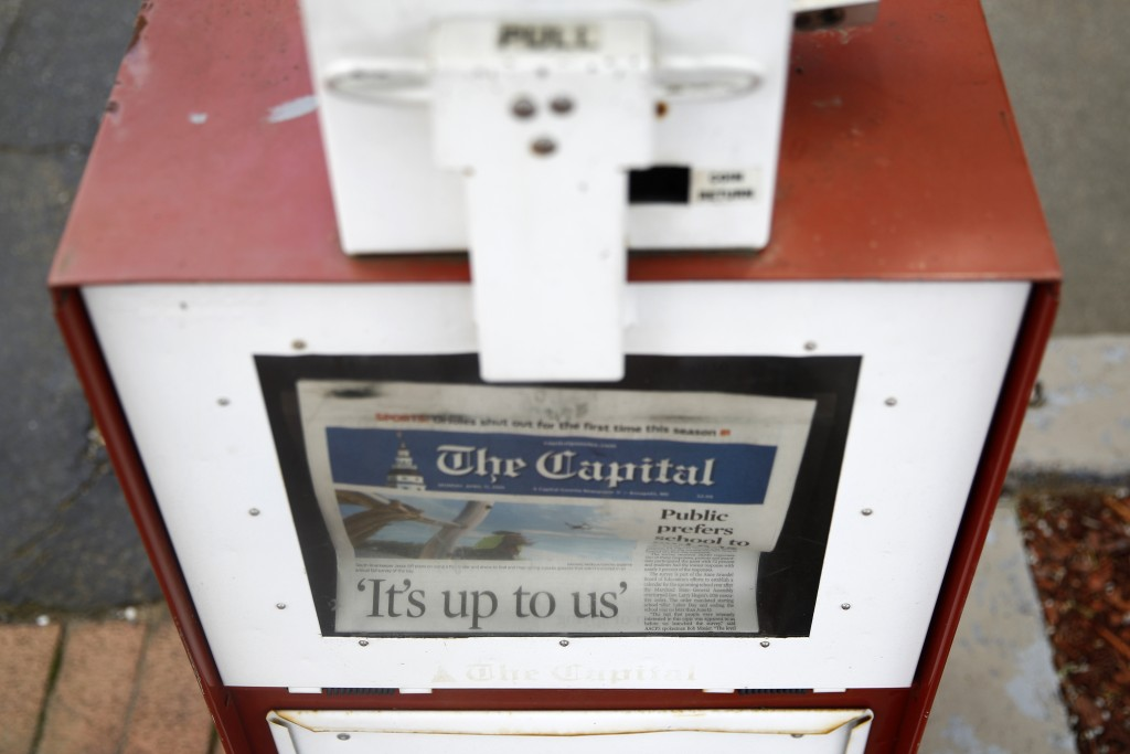 A copy of the day's Capital Gazette newspaper rests in a newsstand, Monday, April 15, 2019, in Annapolis, Md. The Pulitzer Prize board awarded the Cap